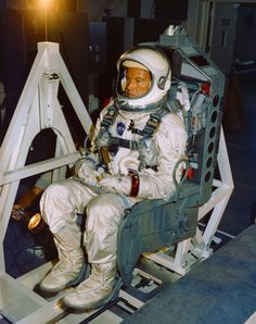 July 7, 1965 – Gemini 5 astronaut Gordon Cooper is weighed and balanced in the Pyrotechnic Installation Building at Cape Canaveral in Florida. (NASA)