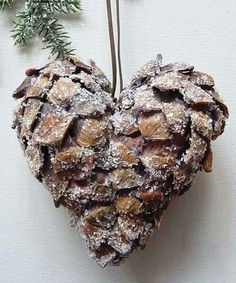 OMG I'm going to make this... glue 2 pinecones together to make a heart Christmas ornament and sprinkle with glitter snow (needs red berries!).