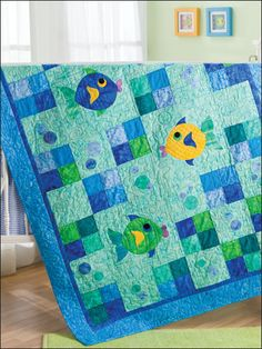 Fish & Bubbles Quilt Pattern Download from e-PatternsCentral.com -- Add circles in a variety of sizes to create the bubbles shown on the plain squares in this playful quilt.