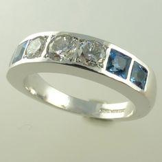Diamond and aquamarine half-eternity ring