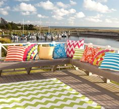 This porch is certainly an inspiration for mixing bright colors and bold patterns! How could you not be happy sitting on a porch like this?