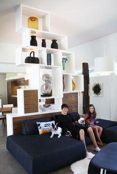 apartment therapy house tour: deron & marye's modern geometry. shelving unit = amazingness.