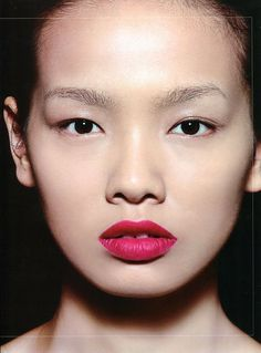Bare face paired with a striking red #lip. #makeup