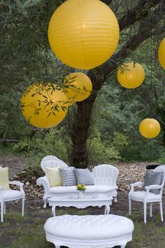 Love this idea for a reception! A modern lounge setup - thrifted furniture and spray paint. Then top it with paper lanterns - which we carry (in this fab yellow + many other colors!!). Originally from SMP!