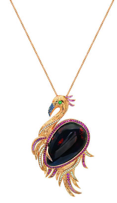 The 18-karat  rose gold pendant is dressed up with round brilliant-cut diamonds, pink and blue sapphires, emeralds, rubies and a 5-gram amber in the centre.