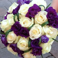 Purple lisianthus and ivory roses, but not so much greenery