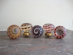 Artist collection handmade glass knobs by Merlin Glass, via Flickr