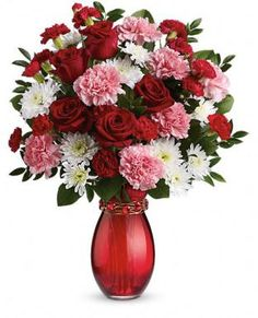 """Teleflora's """"Get a Room"""" Sweepstakes - Thoughts of Happiness  Teleflora's Sweet Embrace Bouquet #ValentinesDay #ManCave  (Available on Teleflora.com starting at $69.95)  Score big with this 3-in-1 gift! Classic red roses with pink and white blooms, a hand-blown glass vase and a sparkling heart bracelet are the keys to romance—and perhaps your new Man Cave, too.  (Stay tuned for my review of this beauty!)"""