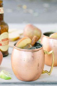 Apple Cider Moscow Mules: Cinnamon, apple cider, ginger vodka, lime and ginger beer... the best!