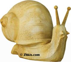 Large Snail Garden Statue - Large snail for garden statue. This big slug is 21 inches long and 15 inches high a great piece for a Lake house or a beach house or just a neat piece for your garden. Several finishes to choose from.