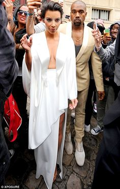 The Bride's in White! Kim Kardashian Wears Sexy White Dress on the Eve of Her Wedding: Photo Kim Kardashian wears a super low cut, sexy dress as she and Kanye West head out of their residence on Friday evening (May in Paris, France. Kim Kardashian Kanye West, Kim Kardashian Closet, Kim Kardashian Wedding, Estilo Kardashian, Kim And Kanye, Kardashian Style, Kardashian Jenner, Kanye West Wedding, Hip Hop