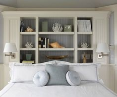 Consider built in behind bed - I could still have the upholstered headboard and start the shelving a bit higher