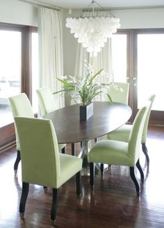 Gray walls, white chandy, Walnut table and floors and green chairs, I would use red and yellow dishes