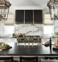 Old and new, stone and metal, brass and black, polished and matte. This kitchen is full of juxtapositions. Designed by Frank Ponterio