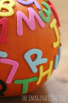 Make alphabet pumpkins and 5 playful literacy games to go with them!