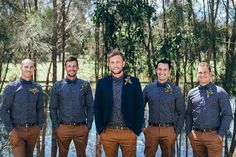 Groomsmen wearing navy patterned shirt, bow tie and brown slacks