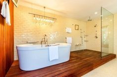 Jimmy Kimmel - The spa-worthy master bath in the talk show host's Hollywood lair boasts a large soaking tub and an overhead rain shower situated on a sauna-like platform. Timeless Bathroom, Beautiful Bathrooms, Spas, Plank, Next Bathroom, Bathroom Ideas, Open Bathroom, Hollywood Hills Homes, Shower Floor