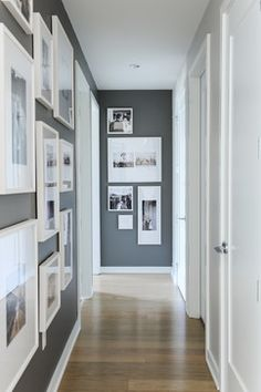 Beautiful gallery wall layout with black and whites. Loving the wall color too, which is Kendall Gray by Benjamin Moore