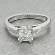 This is a Estate Platinum 14k Solid White Gold .98ct Princess Diamond Solitaire Ring EGL. This ring suggested retail price is $8,200 USD. It will come in a love