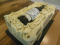 Wine bottle cake - made with cake, buttercream, fondant. The bottle is made from isomalt sugar and is completely edible. #wine #cake #groomscake