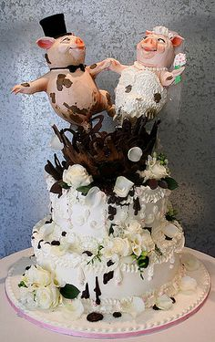 Haha happier than pigs in mud! This so could be my wedding cake one day... Don't think my boyfriend would like it