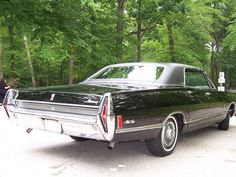 """The 1968 Mercury Park Lane Brougham, driven by Jack Lord in the original """"Hawaii Five-0"""". The car has been restored to it's original condition, the personalized plates read """"BOOK EM""""."""