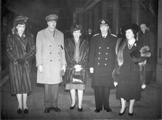Royal brothers, prince Henry, Duke of Gloucester (standing between his wife Alice on his right, and Princess Marina, Duchess of Kent, recently widowed wife of Prince George, Duke of Kent), and King George VI( with his wife Queen Elizabeth).