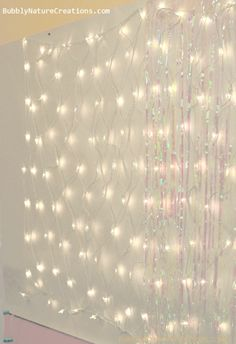 Disney FROZEN Party Decor Ideas!  Use strands of the clear lights with white gauzy material hung in front of it for a beautiful backdrop for photos!!!