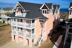 BEYOND THE SEA, #156 l Kill Devil Hills, NC - Outer Banks Wedding and Event Home l Oceanfront providing 12 bedrooms (10 master suites), elevator, recreation lounge, sports bar, home theater, heated pool, hot tub, poolside cabana, private beach walkway and dune-top deck. l www.CarolinaDesigns.com
