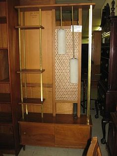 A room dividing, lighted, panelled, mid century shelf unit.