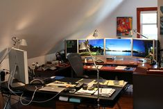 I like the desk layout. It's rare to see a multiple monitor workspace that actually has some light.