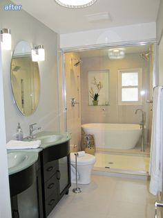 Small bathroom but has both bath tub and shower! Love the light fixture in the tub/shower area, too.