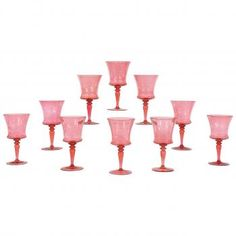 """0 Steuben """"Gold Ruby"""" Hand Blown Crystal Goblets W/ Engraved Armorial Crest  An unusual and rare set of 10 Steuben large goblets in hand blown crystal. The goblets have simple, elegant lines and proportions and one color throughout- Frederic Carder's Steuben iconic """"Gold Ruby"""". Ca. 1920 http://eliseabramsantiques.com/glass/10-steuben-gold-ruby-hand-blown-crystal-goblets-w-engraved-armorial-crest"""