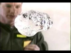 NASA astronauts demonstrate a water bubble bursting at zero gravity. Filmed on VHS in 1996.