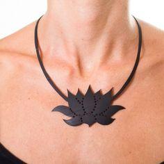 Nice idea: recycled inner tube lotus necklace by Morgana Crea: https://www.facebook.com/morgana.crea1