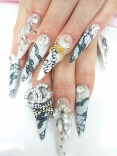 Pointy nails...bling bling
