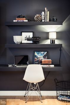 floating shelves, charcoal gray walls, shell chair, floating desk http://www.mbzinteriors.com