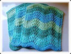 This is a variation of the feather and fan dishcloth pattern found HERE