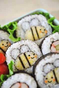 Honey Bee Sushi Roll-- I think you make a medium oval roll colored with egg yolk-- then two smaller round rolls-- then roll in a bigger one.  Decorate each individually