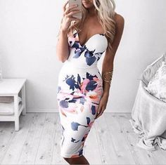 """Item Type: Dress Material: Polyester Sleeve Length: Sleeveless Collar: V-Neck Pattern: Print Style: Sexy Color: White Size: XS (US size) Bust: 31-33"""", Waist: 23-25"""", Hips: 33-35"""" S (US size) Bust: 33-"""