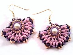 This tutorial also can be watched on youtube : https://www.youtube.com/watch?v=4HB1OZtwKIg -------------- Material list: Material list (as used for these earrings) : 8mm Swarovski pearl Miyuki Delica beads black 11/0 Miyuki seedbeads 11/0 galvanised light beige Superduos Lilac Luster