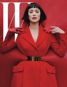 Marion Cotillard  W December Issue cover    Imagery: Red is the color of sacrifice, hands show her secret Handlers, Mind control (MK Ultra), Black white red favorite colors of the Elite (think Nazi party, communism, etc)