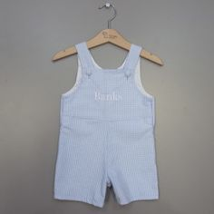 Classic and timeless, this romper combines the finest cotton seersucker fabric to complete this handsome ensemble.These shortalls are perfect for a personalized new baby gift, Easter outfit or for any spring occasion.  Made with a poly/cotton blend seersucker fabric which makes for easy care, these shortalls are precious with a monogram for a new baby gift or baby shower gift. Personalize them with red thread for a stand out look for any patriotic occasion.
