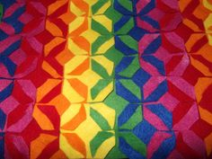 My rainbow version of this felt trivet from http://howaboutorange.blogspot.co.uk/2012/03/make-modular-felt-trivet.html. Cutting the triangles out too an age but it was worth it.