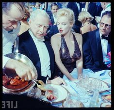 Marilyn Monroe - 1957.04.11 And Arthur Miller With Britain Ambassador Winthrop Aldrich At An April In Paris Ball Held At The Waldorf Astoria, New York, April 11th 1957. (Photo By Peter Stackpole-The LIFE Picture Collection-GettyImages)