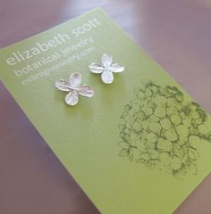 Tiny Hydrangea Flower Post Earrings; $30.00    (Hydrangeas were used in our reception centerpieces)