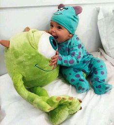 This has got to be one of the most adorable baby photos I've seen. Baby Boy Sully Onesie with Sully Beanie and Mike Wazowsky Stuffed Toy