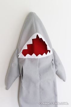 Ever since Shark Week was on the Discovery Channel in August, Reed has been begging me to make him a shark costume for Halloween. I looked through all the pattern books and JoAnn Fabrics and was unable to find a single shark! Google to the rescue....