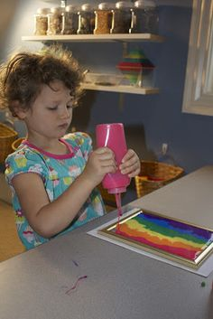 Glue + Food Coloring on glass picture frame= Sun Catcher!