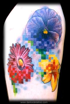 Nick Baxter - Pixel flowers    I just love the unique touch Nick put on this tattoo. I would never have thought to 'reduce the resolution' of the tattoo!
